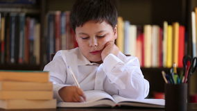 Writing boy at home doing homework stock footage