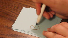 Writing brave. Hand writing the word brave on a card stock video