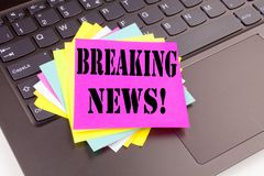 Writing Breaking News text made in the office close-up on laptop computer keyboard. Business concept for Newspaper Breaking News W Royalty Free Stock Photos