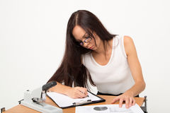Writing brunette business lady Royalty Free Stock Photos