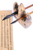 Writing brush and book. Chinese writing brush and the enlightenment of ancient book, china's traditional education to enlighten royalty free stock images