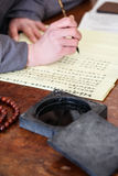 Writing brush calligraphy. Close up of hand scene are writing brush calligraphy Stock Photography