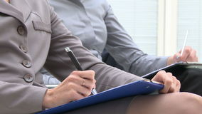 Writing business documents stock footage