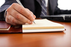 WRITING BUSINESSMAN Stock Photo
