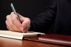 Writing businessman Stock Photo