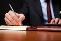 Writing businessman Stock Images