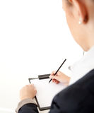 Writing businesswoman with clipboard and pen Stock Images