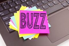Writing Buzz text made in the office close-up on laptop computer keyboard. Business concept for Buzz Word llustration Workshop on. The black background with stock photography