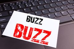 Writing Buzz text made in the office close-up on laptop computer keyboard. Business concept for Buzz Word llustration Workshop on. The black background with royalty free stock photography