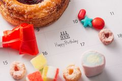 Writing cake on calendar happy birthday.  stock images