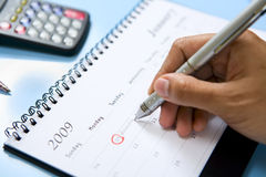 Writing on calendar Royalty Free Stock Images