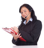 Writing call center young woman in headset Royalty Free Stock Photo