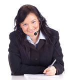 Writing call center young woman with headset Royalty Free Stock Images