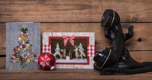 Writing or calling friends on christmas time. Wooden background Royalty Free Stock Images