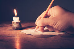 Writing by candlelight Royalty Free Stock Photography