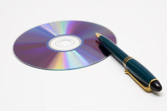 Writing a CD. A pen and a CDROM royalty free stock photos