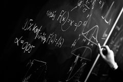 Writing on chalk board. In black and white stock photography