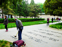 Writing characters with a brush at tiantan park stock image