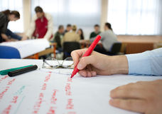 Writing on chart during workshop Royalty Free Stock Images