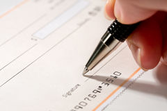 Writing a check 1. Close up of someone writing a check Royalty Free Stock Photography
