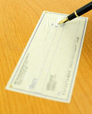 Writing a check. Using a fountain pen, focus on the nib Royalty Free Stock Photo