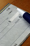 Writing a check Royalty Free Stock Photo