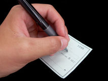 Writing a Check. On Black Background Stock Photos