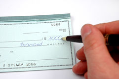 Writing a check. On white background Royalty Free Stock Images