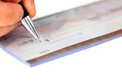 Writing a check Royalty Free Stock Photos