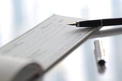 Writing the check Stock Photos