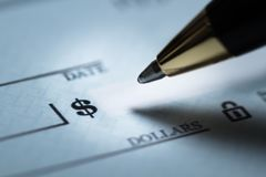 Writing a check. Check finance writing pen writing a check paying blank check Stock Photos