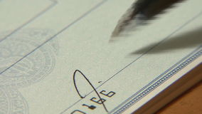 Writing Checks. Signing a bank check stock video