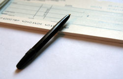 Writing a Cheque 2. Cheque and Pen royalty free stock images