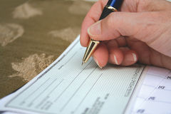 Writing a Cheque Stock Photos