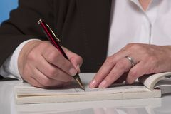 Writing a cheque Stock Image
