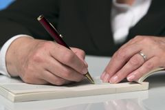 Writing a cheque 3 Royalty Free Stock Photos