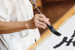 Writing Chinese Calligraphy Stock Photos