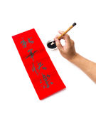 Writing of chinese new year calligraphy, phrase meaning is happy Stock Image