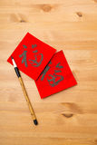 Writing chinese new year calligraphy, word Fuk meaning is good l Stock Photos