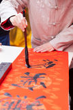 Writing Chinese spring festival couplets Stock Photos