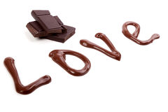 Writing with chocolate - love Stock Images