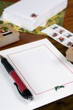 Writing Christmas Cards. The preparations for writing christmas cards lays on a table Stock Image