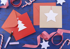 Writing Christmas Cards on Blue Table. Royalty Free Stock Photography