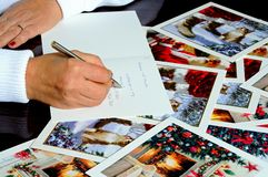 Writing Christmas cards. Royalty Free Stock Image