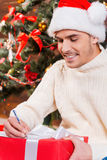 Writing Christmas letter. Stock Photography