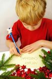 Writing Christmas wishes stock images