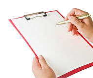 Writing on clipboard Stock Photography