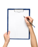 Writing on clipboard Royalty Free Stock Photos