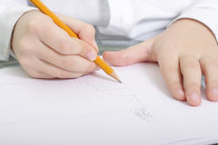 Writing close-up. Child hands writing and drawing with pencil close-up Royalty Free Stock Image