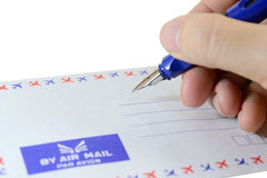 Writing. Close up of hand writing address on the letter Stock Image